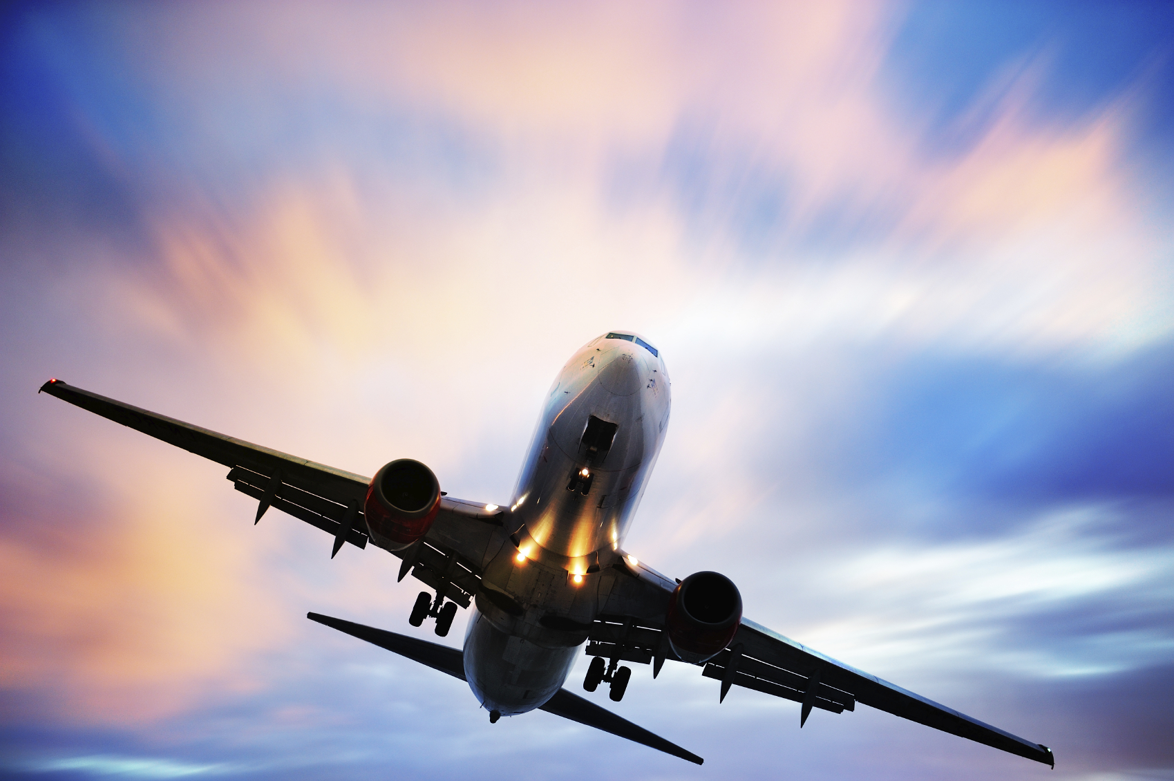 Airplane-taking-off-against-blue-and-pink-sky1